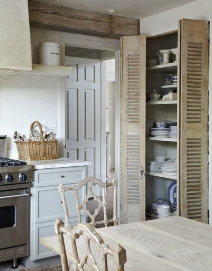 I love the neutral palette and the texture from the wood beams, shuttered doors, marble counters and stainless oven!