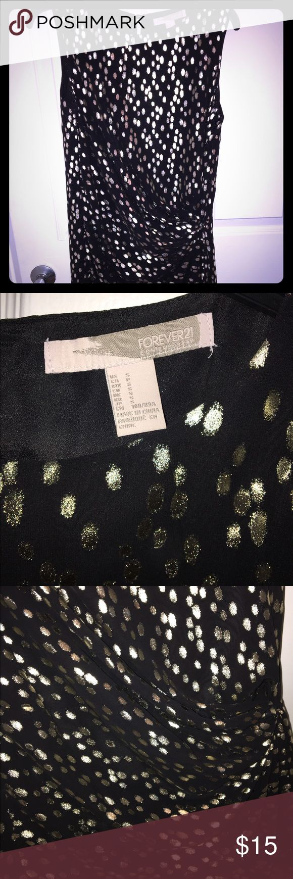 Black and gold metallic party dress LBD with gold metallic accents. Material drapes to the hip to give the dress a beautiful shape. Forever 21 Dresses Midi