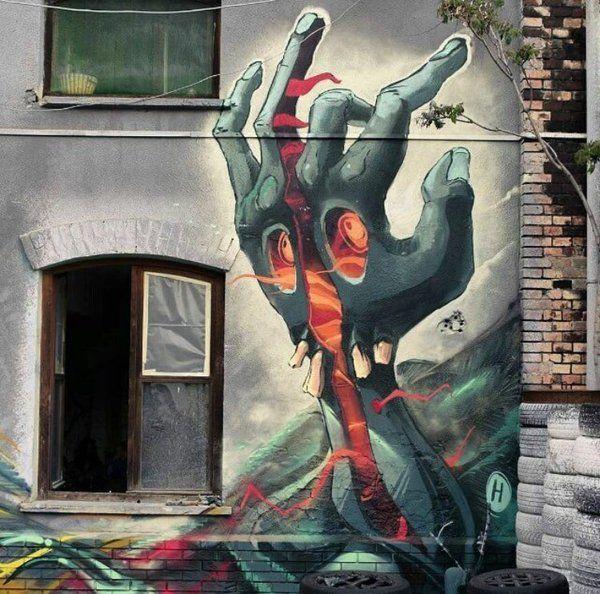 Nuovo pezzo dello street artist ungherese Fat Heat a Budapest, Ungheria.