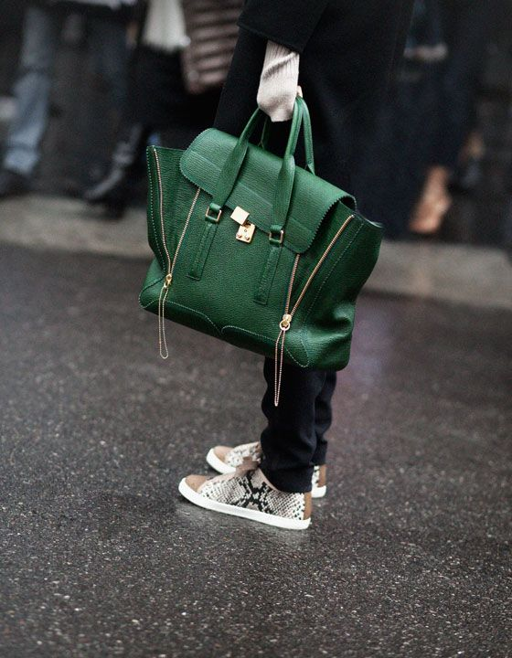 My dream bag of the moment... excuse my drool. The luxe green leather is to die for. Garance shot this on Amanda Brooks, the fashion director of Barney's New York.