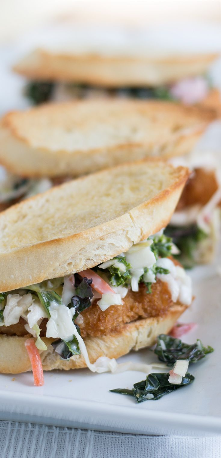 Chicken Schnitzel & Kale Slaw Sandwich-ettes: Put these fried chicken sandwiches together for a small crowd tonight! Absolutely delicious with a quick slaw of kale, carrots, cabbage, red onion, parsley, seasonings, mayo, olive oil and apple cider vinegar.