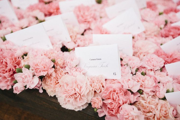 shades of pink carnations escort card table boxes