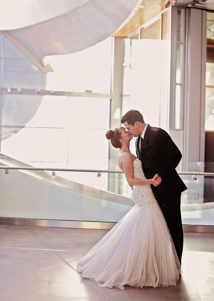 Love this photo of a bride and groom at their art gallery wedding in Edmonton, Alberta.