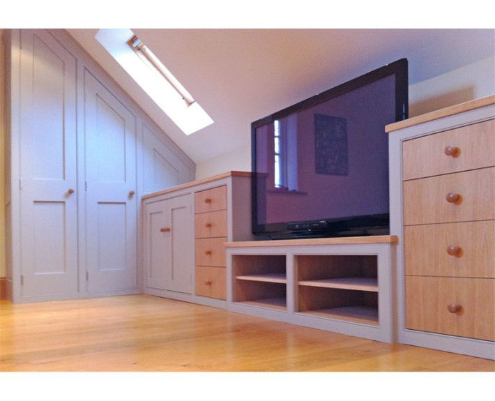 An attic den for a teenager. We fitted handmade furniture under the eaves to maximise the use of space and create an airy, open area.