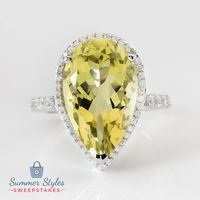 This shimmering yellow quartz ring may give the sun a run for its money! Which makes it the perfect accessory for a tropical vacation! || 8.00ct Pear Shape Lemon Quartz With .17ctw Round White Zircon Sterling Silver Ring [Promotional Pin]