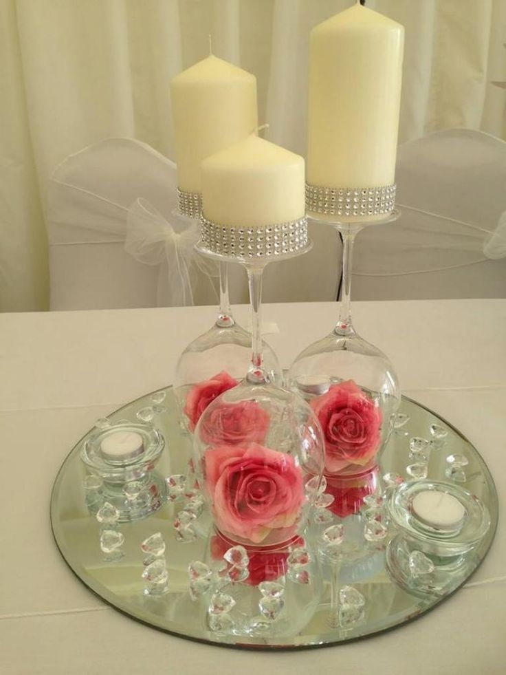 Pink flower upside down wineglass centerpiece