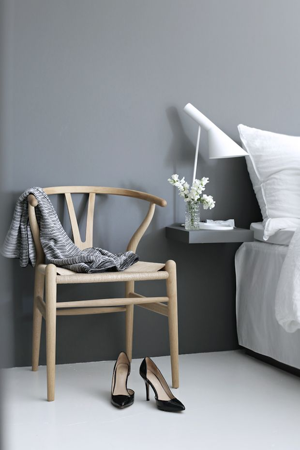 Wishbone Chair And A Grey Wall In The Bedroom Of A Serene Norwegian Home On  A