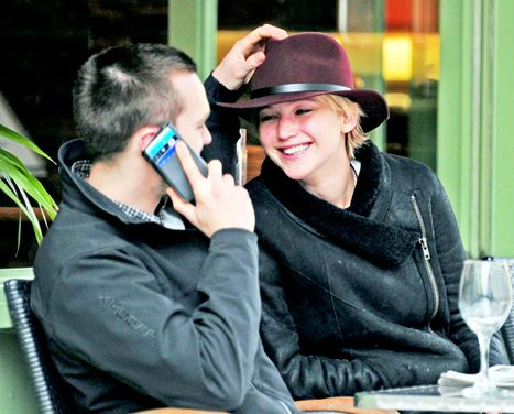 Jennifer Lawrence and Nicholas Hoult look smitten as they dine at an outdoor cafe in London