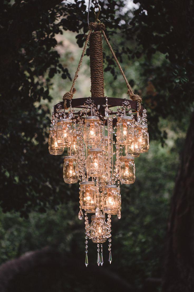 vintage wedding decor with mason jar wagon wheel chandelier