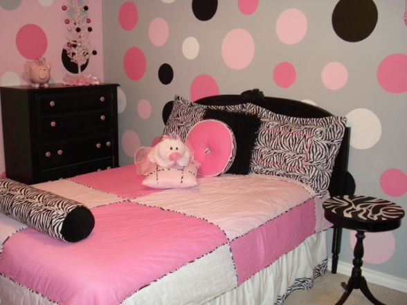 My daughter wanted polka-dots on her wall so I took different size lids off my pots and traced the circles onto the walls and then painted them in.  WHAT A PAIN!  She loved it so that is all that matters.     , Girls Rooms Design