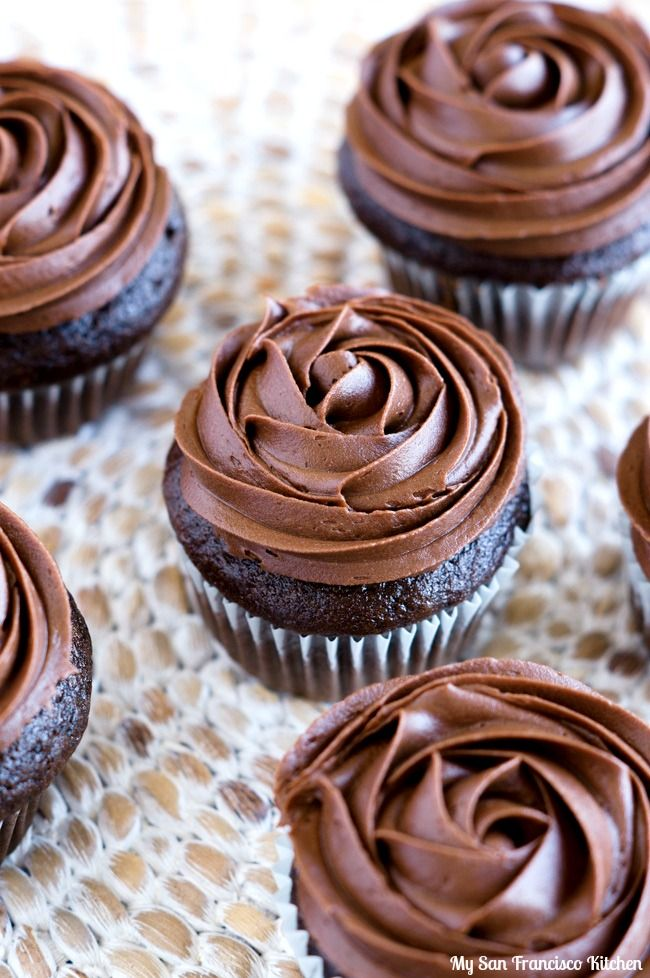 A recipe for chocolate cupcakes filled with chocolate pudding and decorated with chocolate frosting roses on top.