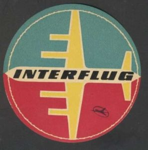 Classic Interflug (state airline of the DDR / East Germany from 1963 - 1991) luggage tag with a stylized Ilyushin Il-18, one of the best-looking East bloc airliners. There's a great restaurant named after this airplane in the Leipzig/Halle airport. Last time I was there, they let me take a menu as a souvenir. I am a geek.