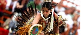 A young traditionnal Wendat dancer performing at Wendake's Annual Pow Wow in summer; one of many activities going on around Hotel-Musée Premières Nations.  15 minutes from downtown Quebec City.