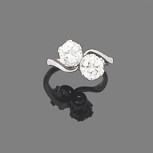 A diamond two-stone ring  Obliquely-set with two brilliant-cut diamonds, diamonds approx. 1.05ct. each,