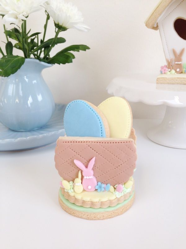 Easter basket with Easter egg cookies, all completely edible and made from vanilla biscuits and fondant icing.  Available from nilaholden.co.uk