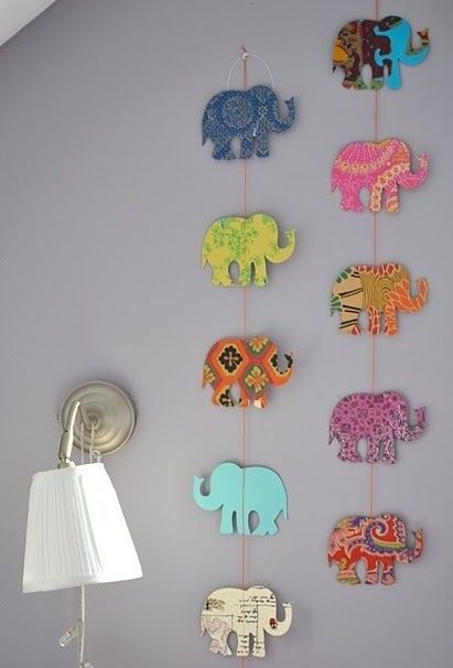 Scrap booking paper + homemade stencil  Such a cool idea to add some color in your residence hall room!