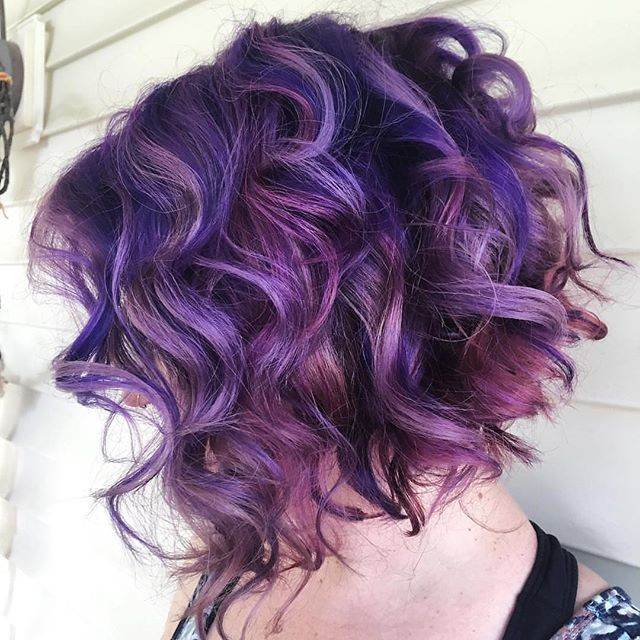 Flirty Curly Purple-y Bob  by @lzhouseofhair  Every time we look at this pic we smile!  #hotonbeauty