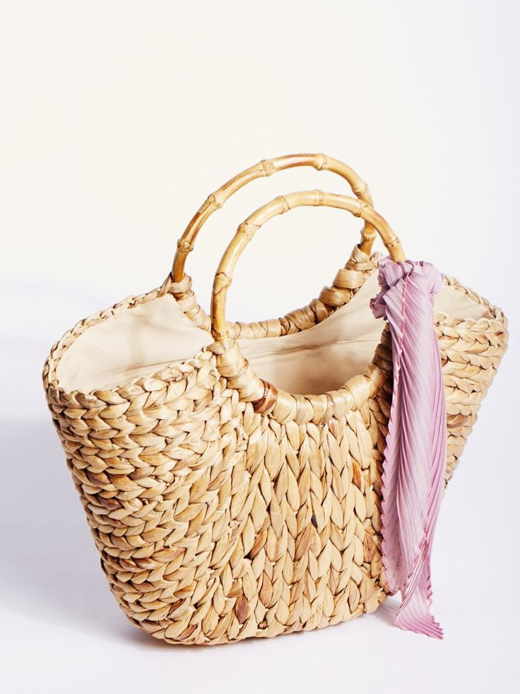 Sunday Straw Tote | Woven straw tote with an easy, natural feel. Features circular bamboo handles. Lined.
