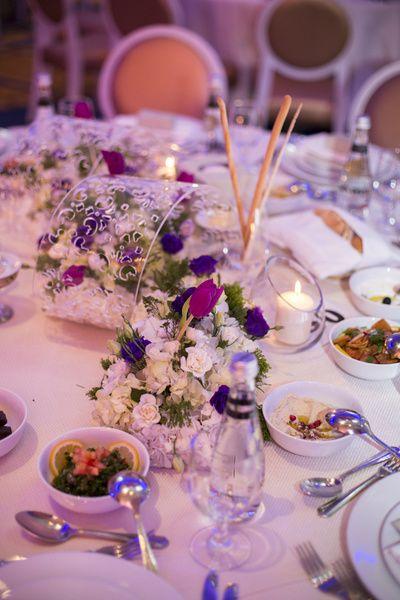 floral arrangement, spilling over florals, clear plastic vase, unique table centerpieces,