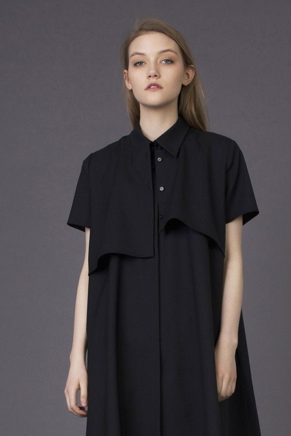 6c111b79471 fluid black shirt with pocket at the back