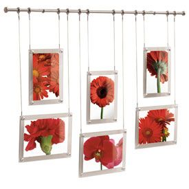 The Mounted Hanging Picture Frame Set is a fun and innovative way to display pictures and works of art. Featuring a 25 inch brushed-nickel hanging rod this six frame set includes three 3.5x5 glass picture frames and three 4x6 glass frames. All six frames are suspended from stainless steel picture hanging wire tested to