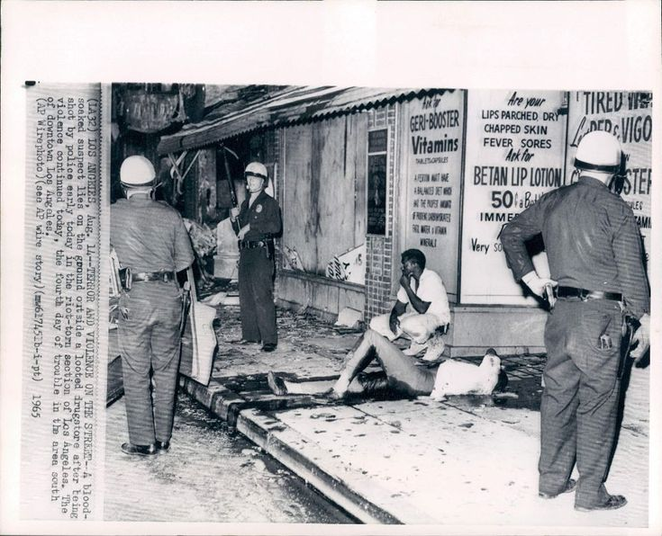 L.A. COLLECTION:Watts Riots Looter is Shot by Police (1965) Photo by William Reagh