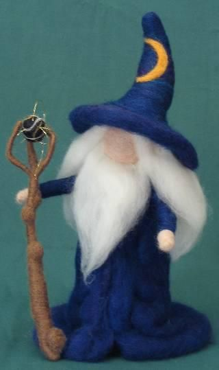 "By Patti Michaels, 2007, of Portland, Oregon.  ""Wizard,"" solid wool, poseable arms, removable staff, 7 inches tall.  Additional work can be found at etsy.com/shop/fireandmice."