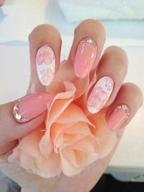 Pink and white stiletto flower nails with rhinestone.