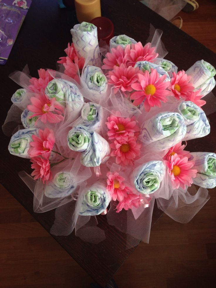 diaper flower bouquet. Used 20 diapers, tule, gift tissue and a basket.......and voila!