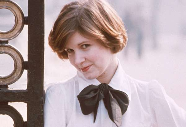 Young Carrie Fisher in White Buttondown with Black Bow