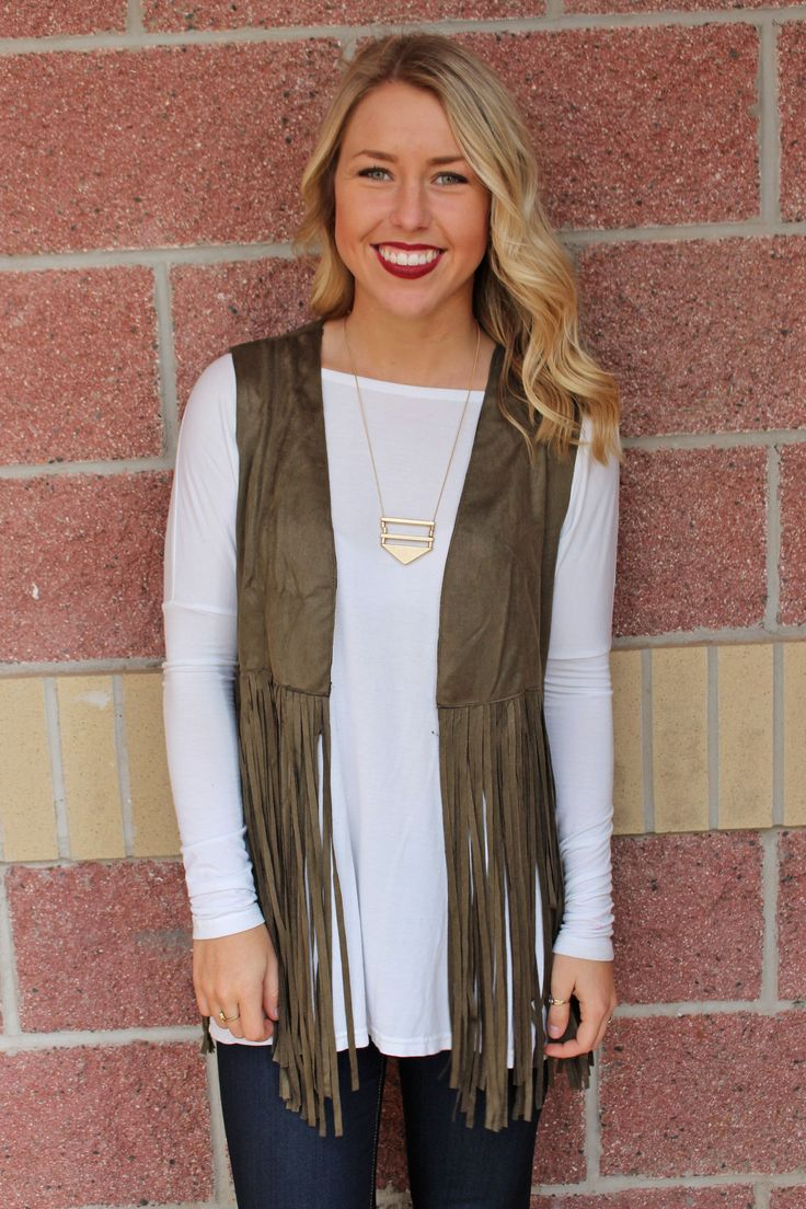 Suede vest with long fringe. This adorable, lightweight fringe vest is a must have and on everyone's wishlist! We love it layered over our printed chiffon blouses! Also great layered over any Piko top
