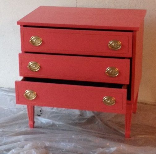 Inexpensive dressers repainted in coral. Hardware refreshed with metallic spray paint.