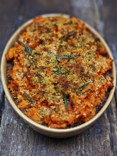 Jamie's vegan shepherds pie recipe is a warm and comforting treat; topped with a root mash and breadcrumbs this vegan shepherds pie is a…