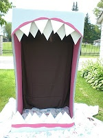 Cute Halloween photo booth idea! Some kind of monster mouth...mayb try an get a couple of these an put together for rabbit whole.