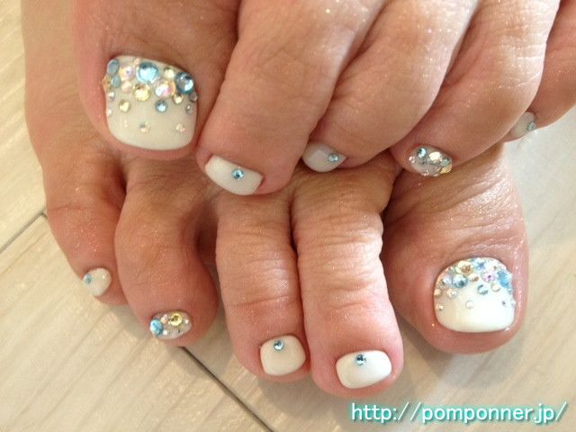 Foot nail studded with colorful rhinestones at the base