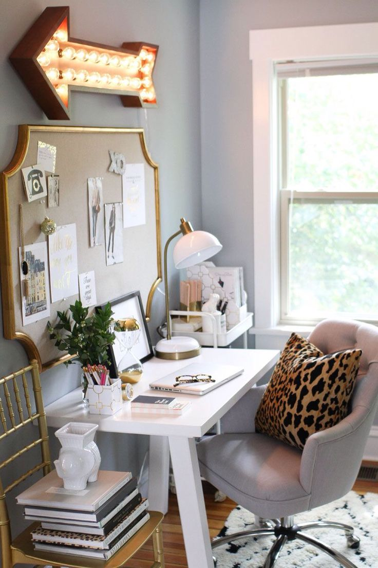 love the white desk, gold accents, arrow, the white shelving unit, comfy chair and rug. and the wall color