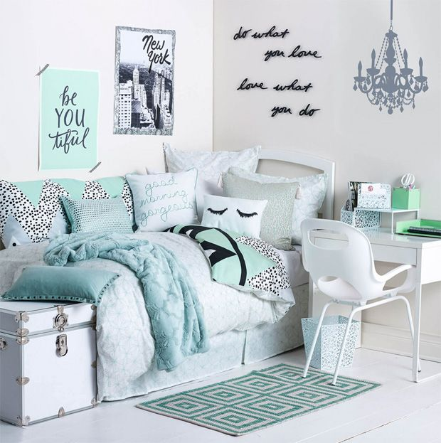 Teal, pale blue, and white dorm room bedroom design