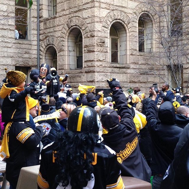 #HereWeGo! Steelers fans gather for a free rally at noon today in the courtyard at the County Courthouse in Downtown Pittsburgh. (photo by Jeff Schreckengost) The Steelers play the Kansas City Chiefs in the NFL Playoffs on Sunday.