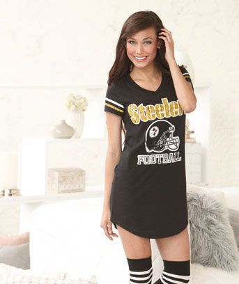 Support your team while you catch some Z's in a Women's NFL Nightshirt in a Can. Wear it on its own on warm nights, then over your own leggings as it gets colder. The V-neck nightshirt has a team logo with stripes on the sleeves. I
