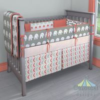 Crib bedding in Coral and Teal Arrows, Solid Coral, Gray Embrace, Gray and White Elephants, Coral and Teal Chevron, White and Gray Elephants, Coral and Gray Triangles. Created using the Nursery Designer® by Carousel Designs where you mix and match from hundreds of fabrics to create your own unique baby bedding. #carouseldesigns