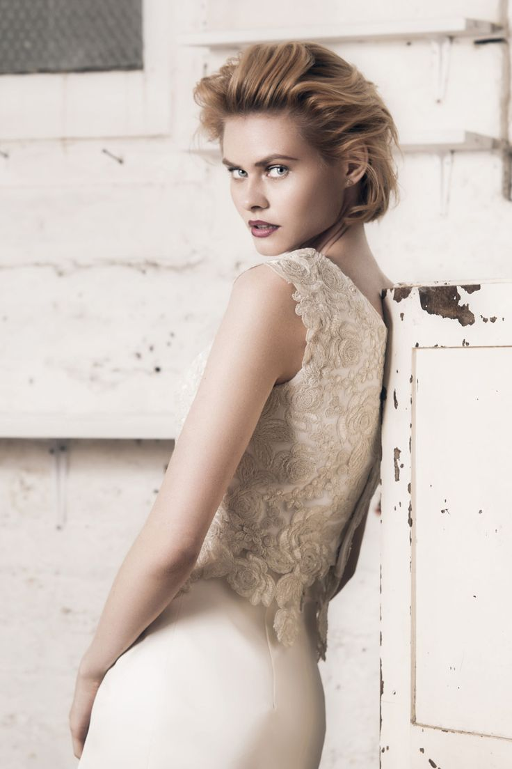 Modern wedding dress for the contemporary bride. Helen top. Corded lace top with applique cap sleeves and mini peplum..
