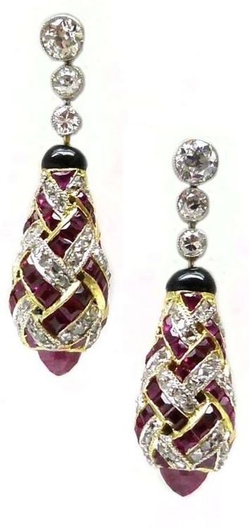 Pair of antique ruby and diamond earrings, bombe drops formed by a lattice of rubies and diamonds, suspended from a line of three diamonds, c.1910. Via S.J. Phillips.