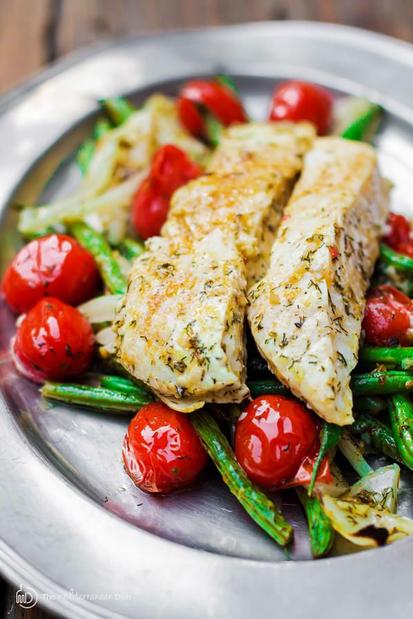 A 30-minute halibut recipe with green beans and cherry tomatoes. Bakes in Mediterranean sauce w/ olive oil, lemon juice, garlic and dill! The best!