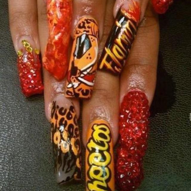 Hot Cheeto nails. Dangerously cheesy