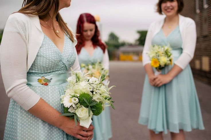 Bridesmaids wear polka dot dresses for a 1950's inspired  rustic wedding at Danby Castle in North Yorkshire. Photography by http://www.stottandatkinson.com/