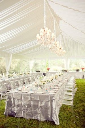 A marquee doesn't have to have flooring.. An amazing effect is created here by contrasting the stark white of the marquee and lighting, with the bright green of the grass. Stunning.. Ask Rays Marquees how you can make a grassy landscape work for your marquee wedding www.raysmarquees.co.uk