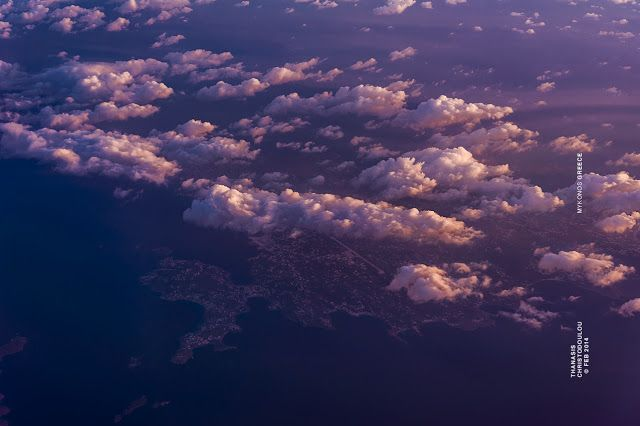Mykonos from airplane. Amazing Cloudy sky with warm colors. #clouds #greece #mykonos #island #sea #airview #hellas #μύκονος