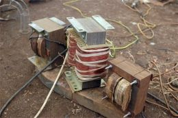 Arc Welder - Homemade welding machine constructed from lumber, copper wire, metal plates, angle iron, bolts, and nuts.