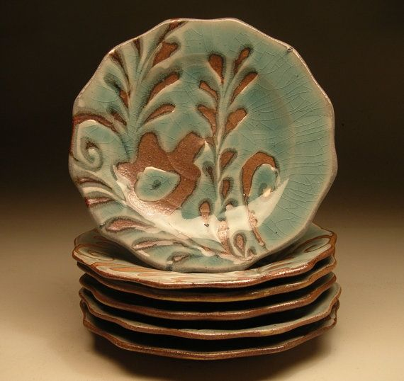 """Loretta Languet   I just completed an entire dinnerware set for a customer and she was thrilled with the pieces and how they work within her house. The lush hue and texture of the salt fired stoneware dramatically contrast yet compliment the gloss of a rich celedon blue. This is a smaller dinner plate aprx. 8.5-9"""" diameter. The under belly and foot are hand carved/trimmed and salt glazed brown."""