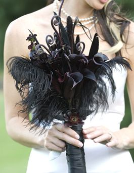 #blackflowers LOVE this one, again not sure about feathers. LOVE the curly things.